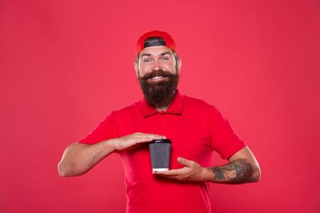 Tasty coffee. perfect morning with coffee. good morning coffee to go. Barista recommend caffeine beverage. bearded man drink from paper cup. brutal hipster red uniform. Coffee shop staff wanted Standard-Bild