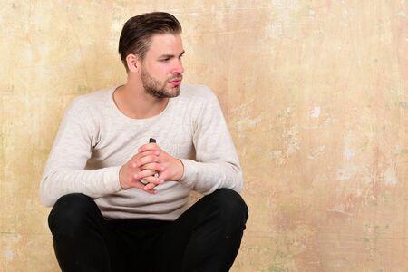 Macho sits on beige texture background. Communication concept Banco de Imagens