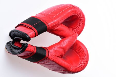 Pair of boxing gloves lying on each other.