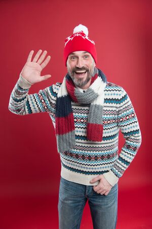 Happy bearded man welcomes you. Cold winter conditions. Knitted accessories. Winter weather style. Winter male fashion collection. Mature man enjoy warmth and comfort. Christmas holiday time Banco de Imagens