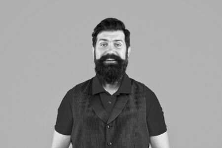 Beard divides boys from men. Bearded man orange background. Happy hipster with long beard hair. Grooming mustache and beard. Barbershop. Barbers salon