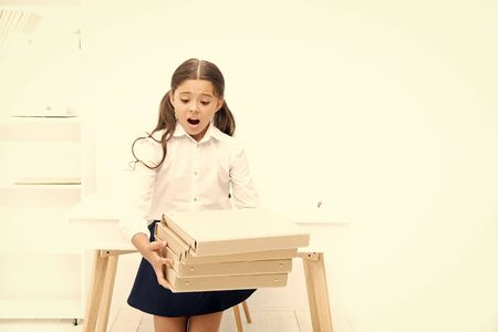 oh no. kid learn and study hard. back to school. shocked girl with workbook folders. Education. heavy documents. Towards knowledge. small girl in school uniform. lot of homework. Get information Foto de archivo