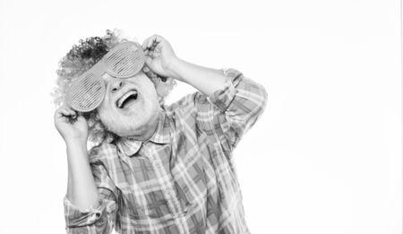 Man senior bearded cheerful person wear colorful wig and sunglasses. Having fun. Funny lifestyle. Fun and entertainment. Comic grandfather concept. Nice joke. Grandpa always fun. Elderly clown. Zdjęcie Seryjne