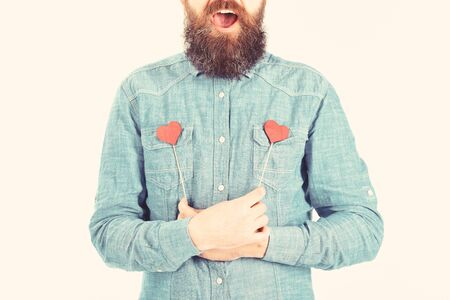 Full of love concept. Brutal man with long beard and open mouth is full of love.