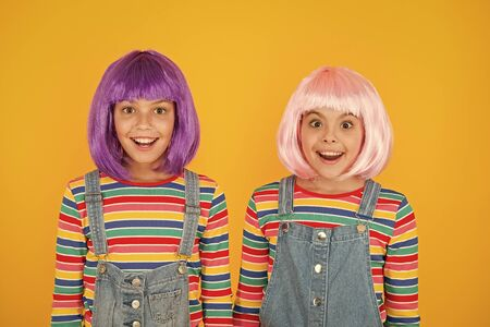 Anime convention. Happy little girls. Anime fan. Cheerful friends in colorful wigs. Anime cosplay party concept. Animation style characterized colorful graphics vibrant characters fantastical themes Stock Photo