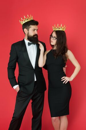 Dont go to prom alone. Prom king and queen. Sensual woman and bearded man wear prom crowns. Coronation party. Holiday celebration. Pride and glory. Luxury reward. Future success. Ready for prom night