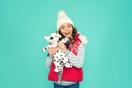 Happy child hold soft toy. Little girl smile with toy dog. Dreaming about real dog. Kids toy shop or store. Winter style. Childhood fun. Lovely baby smiling face. Pets shop. Her favourite toy