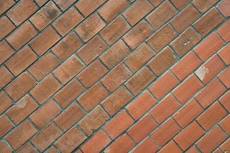 Diagonally layered red brick wall texture background. Building material concept. Industrial background empty grunge urban warehouse brick wall. Surface on masonry background. Decor and design.