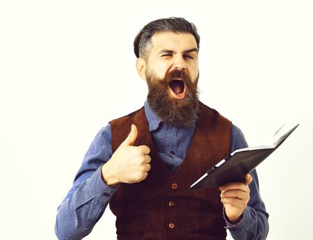 bearded man holding notepad with happy face Stock Photo