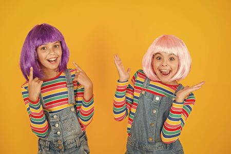 Happy little girls. Anime fan. Cheerful friends in colorful wigs. Anime convention. Anime cosplay party concept. Animation style characterized colorful graphics vibrant characters fantastical themes