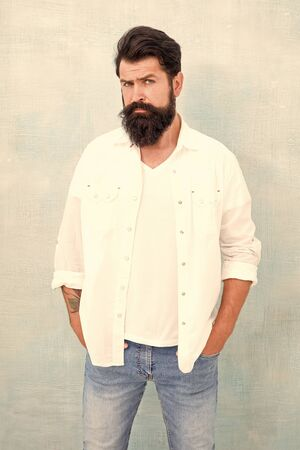 handsome hipster jeans. male fashion and beauty. Masculinity concept. Summer season fashion trend. brutal macho gray background. Male temper brutality. bearded man radiate masculinity