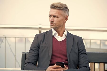 Waiting for message. Modern life demands modern gadgets. Man with smartphone. Mobile phone always with me. Hipster well groomed man use smartphone. Internet surfing social networks with smartphone