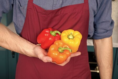 Fresh peppers vegetables in hand of chef. Diversity ingredients. Peak season purchasing ensure your vegetables more flavorful. Seasonal vegetables ingredients can take average dish to another level.