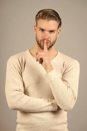 Man handsome attractive silence gesture.