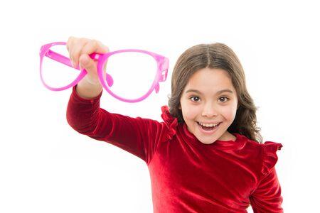 Child happy with good eyesight. Eyesight and eye health. Improve eyesight. Girl kid wear big eyeglasses isolated white background. Optics and eyesight treatment. Effective exercise eyes zooming Stok Fotoğraf
