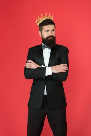 Man bearded handsome guy in formal suit golden crown symbol of monarchy.