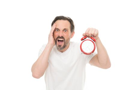 Hate being late. Man hold alarm clock in hand. Guy bearded mature man worry about time left. Time management and discipline. Punctuality and responsibility. Man with clock on white background Stock Photo