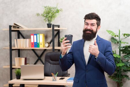 Man bearded manager businessman entrepreneur hold cup of coffee.