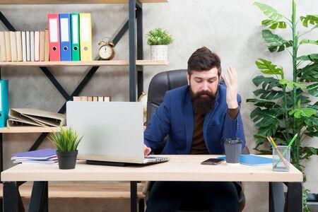 Bearded man in business office.