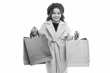 Kid cute little girl hold bunch shopping bags. Child satisfied by shopping isolated white background. Obsessed with shopping and clothing malls. Shopaholic concept. Signs you are addicted to shopping