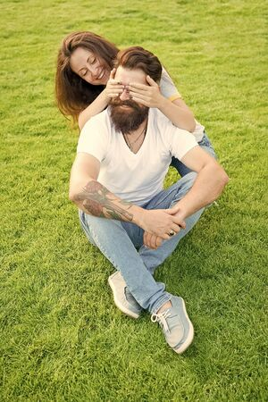 Simple happiness. Couple in love relaxing on green lawn. Playful girlfriend and boyfriend dating. Couple relations goals. Soulmates closest people. Couple spend time in nature. Lovely couple outdoors Stock Photo