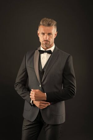 Refinement in every detail. Tailored suit. Fashion shop. Rent suit service. Elegant fashion outfit for event. Gentleman modern style. Guy well groomed handsome macho wear tuxedo. Fashion clothes Фото со стока