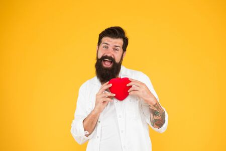 All you need is love. brutal hipster yellow wall. happy valentines day. heart poblems and disease. preventing heart attack. fall in love. love and romance. human organ donor. bearded man red heart