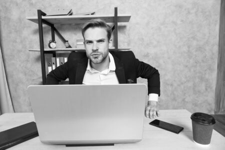 Man strict bearded boss top manager in office. Ceo concept. Leave office right now. Failed job interview. Firing employees. Serious boss picky looking at camera. Boss with laptop in bad mood Stock Photo