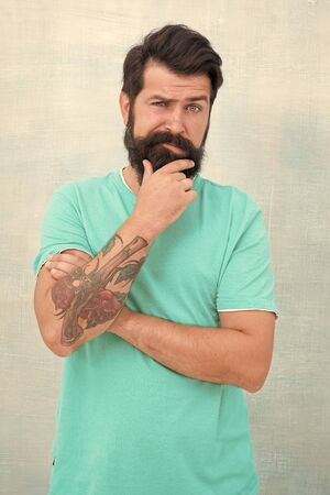My beard my look. Serious caucasian guy touch beard. Unshaven hipster with textured beard hair. Bearded man with stylish mustache and beard shape. Barbershop. Barbers salon