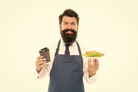 Enjoy your meal. Delicious croissant. Man bearded waiter wear apron carry plate with food and coffee cup. Cafe food concept. Guy serving croissant stuffed lettuce and fresh vegetables. Healthy food Archivio Fotografico