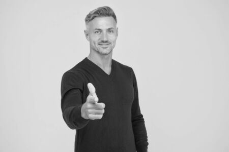 Motivated man. Self confident and motivated. Feeling motivated. You are awesome. Man mature hipster yellow background. Masculinity and brutality. Guy bristle pointing at you. Support and motivation Imagens