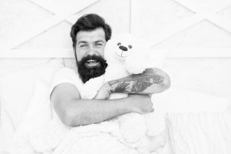 Soft cotton bedclothes. Enough amount sleep every night. Comfort and relax. Tips sleep better. Bearded man relaxing. Circadian rhythm is natural internal process that regulates sleep wake cycle