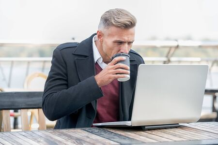 Successful man working in cafe. Good vibes. Modern life concept. Businessman out of office. Freelance and remote job. Coworking space. Man drink coffee work online modern laptop. Modern occupation Stockfoto