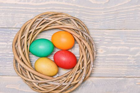 Healthy and happy holiday. painted eggs in nest. Happy easter. Egg hunt. Spring holiday. Holiday celebration, preparation. copy space. Pleasant spring day.