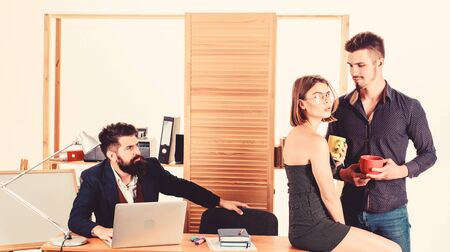 Flirting and seduction. Flirting with coworker coffee break. Woman flirting with coworker. Woman attractive working male colleagues. Office romance concept. Strict boss. She distracts workers