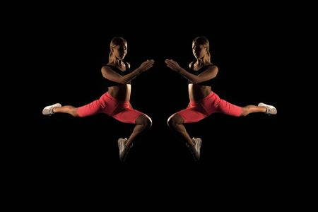 Frozen in motion. Reflection woman athlete run jump fly. How run faster. Speed training guide. Improve run speed. Girl runner on black background. Sport lifestyle and health concept. Start run