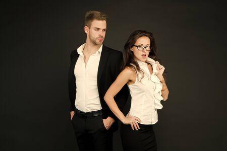 Harmless flirtation. Sexy girl engage in flirtation with businessman. Sensual woman enjoy flirtation with boss man. Couple of business partners. Flirtation and romance. Flirting and teasing Standard-Bild - 139936877