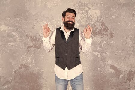 Im always smiling and happy. Bearded man with smiling face on abstract wall. Smiling hipster with mustache and beard hair. Happy guy show ok signs. Dental services. Smiling increases happiness
