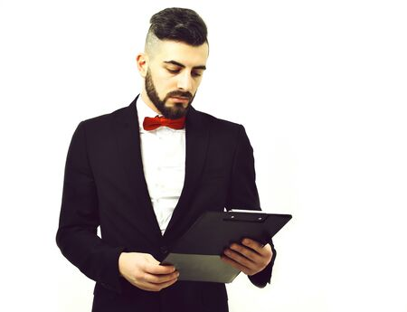 Manager or businessman with beard in suit and red tie