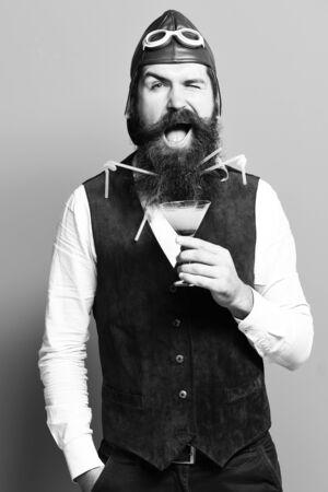 happy handsome bearded pilot on blue studio background