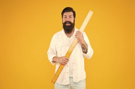 Big size. Measure and control. Geometry theorem. Actual size. School teacher. Small little big large. Does size really matter. Man bearded hipster holding ruler. Measure length. Size tall and length
