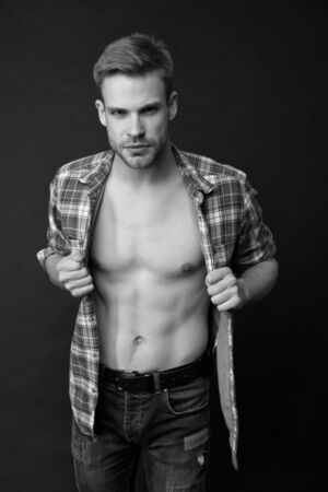 Hes sexy and he knows it. Sexy man in unbuttoned shirt. Handsome guy with sexy bare torso. wellness and bodycare. Attractive and sexy