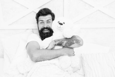 Soft cotton bedclothes. Bearded man relaxing. Circadian rhythm is natural internal process that regulates sleep wake cycle. Enough amount sleep every night. Comfort and relax. Tips sleep better