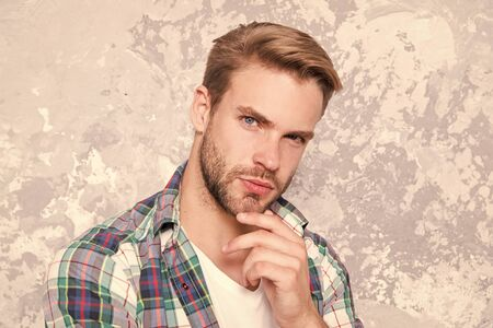 look like know everything. charismatic student checkered shirt. unshaven man care his look. mens sensuality. sexy guy casual style. macho man grunge background. male fashion spring collection 版權商用圖片