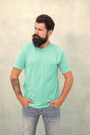 Pure brutal. Hipster wear long beard and mustache in brutal style. Bearded man with brutal look. Brutal caucasian guy isolated on white. Tattoo salon. Barbershop 版權商用圖片