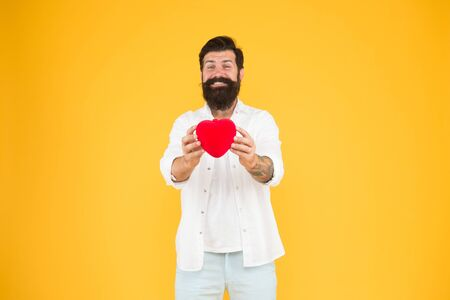 Celebrate valentines day. Romantic hipster sharing love. Spread love around. Generous lover. Love symbol. From sincere heart. Love you. Being honest. Romantic guy with red heart toy. Romance concept