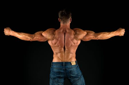 Professional coach demonstrate achievements. Exercises for back. Bodybuilder perfect shape rear view. Strong bodybuilder flexing arms muscles black background. Fit bodybuilder showing muscular body