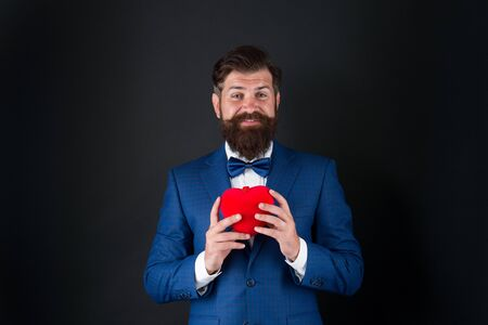You should try it. businessman with bow tie. problems with heart. Romantic greeting. happy valentines day. tuxedo man red heart. love date. mature hipster beard in formal suit. problems with heart 版權商用圖片
