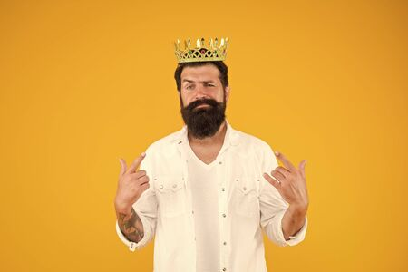 i am cool. brutal and handsome prince yellow background. Egoist selfish man. Narcissistic person. Superiority complex. Bearded man wear white. Love yourself. hipster man king costume party