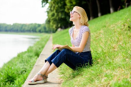reading is my hobby. Summer study. woman in park reading book. interesting story. Relax and get new information. student girl with book outdoor. inspired by novel author. enjoy study and reading book